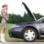 Woman and broken down car